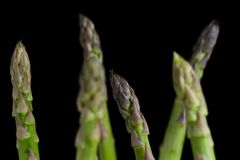 Bunch of asparagus on dark table. Organic, vegetarian and healthy food concept. Closeup. Copy space. Top view Royalty Free Stock Image