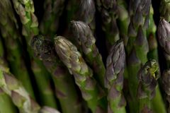 Bunch of asparagus on dark table. Organic, vegetarian and healthy food concept. Closeup. Copy space. Top view Royalty Free Stock Photos