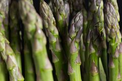 Bunch of asparagus on dark table. Organic, vegetarian and healthy food concept. Closeup. Copy space. Top view Stock Image