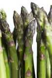Bunch of asparagus on dark table. Organic, vegetarian and healthy food concept. Closeup. Copy space. Top view Stock Photo