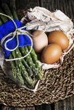 Bunch of asparagus with eggs on centerpiece stock photos