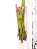 Bunch of asparagus hanging on a door Royalty Free Stock Images