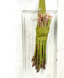 Bunch of asparagus hanging on a door Royalty Free Stock Photos