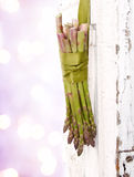 Bunch of asparagus hanging on a door Royalty Free Stock Photo