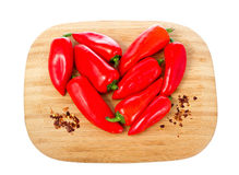 Heart shape made of red hot peppers isolated on wh Royalty Free Stock Photo