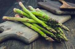 Bunch of asparagus, on lackluster wooden Stock Images