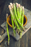 Bunch of asparagus, on lackluster wooden Royalty Free Stock Photography