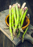 Bunch of asparagus, on lackluster wooden Royalty Free Stock Photo