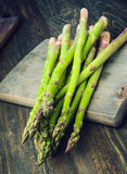 Bunch of asparagus, on lackluster wooden Royalty Free Stock Image