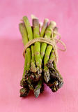 Bunch of asparagus on pink background Stock Images