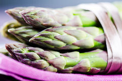 Bunch of asparagus on purple napkin close up Stock Image