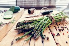 Bunch of asparagus with spices and  cucumber Royalty Free Stock Photography