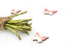 Bunch of asparagus tied with rope, butterflies stock photography