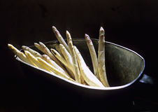 Bunch of asparagus in tin basket Stock Images