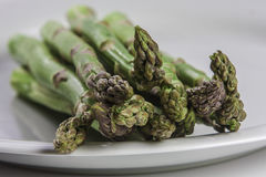 Bunch of asparagus on white plate Royalty Free Stock Photos