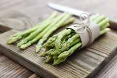 Bunch of asparagus. On wooden background closeup stock photos
