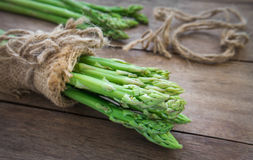 Bunch of asparagus on wooden table Stock Images