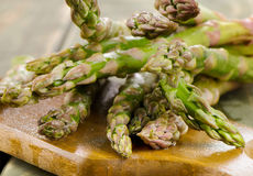 Bunch of  asparagus on wooden table Stock Image