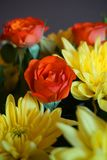 Bunch of autumn flowers with orange roses and yellow chrysanthemums Royalty Free Stock Photos