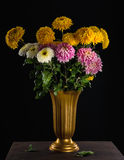 Bunch of autumn flowers in vase Royalty Free Stock Photos