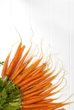 Bunch of Baby Carrots over White Timber Royalty Free Stock Photo
