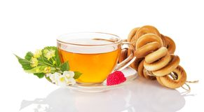 Bunch of bagels and cup with tea. Bunch of bagels, cup with tea, raspberry the jasmine and linden flower isolated on white Stock Images
