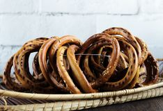 Bunch of bagels with sesame in wicker basket royalty free stock photography