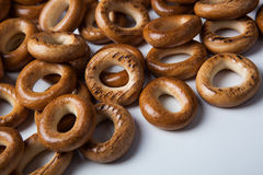 A bunch of bagels on a white background. A bunch of bagels lying on a white background close-up Stock Photo