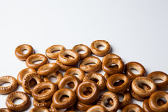 A bunch of bagels on a white background. A bunch of bagels lying on a white background close-up Stock Image