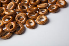 A bunch of bagels on a white background. A bunch of bagels lying on a white background close-up Stock Photography