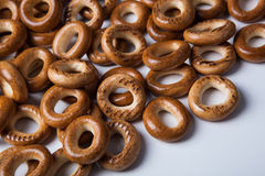 A bunch of bagels on a white background. A bunch of bagels lying on a white background close-up Stock Images