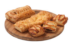 Bunch of bakery products on a wooden board Stock Images