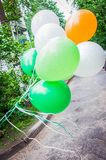Bunch of balloons flying by the wind stock photos