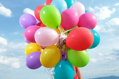 Bunch of balloons held by a man outdoor