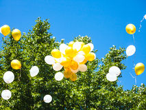 Bunch of balloons rising in blue sky Royalty Free Stock Photography