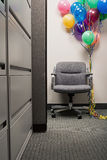 Bunch of balloons tied to office chair Royalty Free Stock Photography