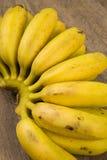 A bunch of banana on wooden background. Cacho de banana madura em cima de uma madeira royalty free stock image