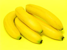 Bunch of Bananas. On yellow Stock Image
