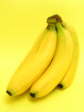 Bunch of Bananas. On yellow Stock Images
