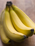 Bunch Of Bananas. A Bunch Of Bananas On A Wooden Service Stock Images
