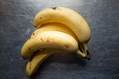 Bunch of bananas in natural light stock photo