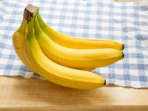 Bunch of Bananas on Blue Checked Cloth Stock Photos