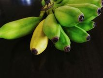 Bunch of bananas. On dark background Royalty Free Stock Images