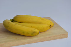 Bunch of bananas  on desk Royalty Free Stock Photos