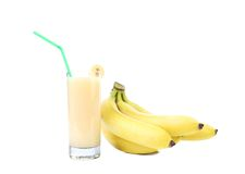 Bunch of bananas and juice. Royalty Free Stock Images