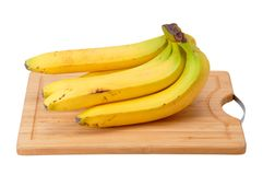Bunch of bananas on the kitchen blackboard Royalty Free Stock Image