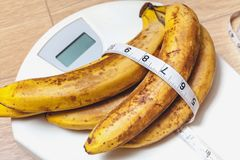 Bunch of bananas lying on floor scales Stock Images
