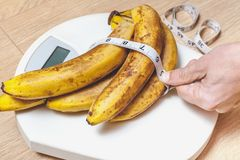 Bunch of bananas lying on floor scales Stock Photos