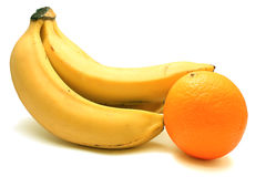 Bunch of bananas and one orange Royalty Free Stock Photos