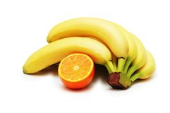 Bunch of bananas and orange is Stock Photo